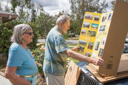 Reminiscing on 20 years of hiking memories, Bill and Phyllis Helm look through their boards full of pictures from previous hikes. Phyllis founded the La Verne Trail Trekkers hiking club in 1995. / photo by Taylor Griffith