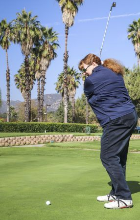 Ann Quay Davis enjoys golf because of the beautiful settings, fresh air, sunshine and exercise. Golf requires concentration, which helps Ann relax and enjoy the moment. She met her husband Larry Davis 20 years ago on a golf course in Las Vegas. / photo by Katie Pyne