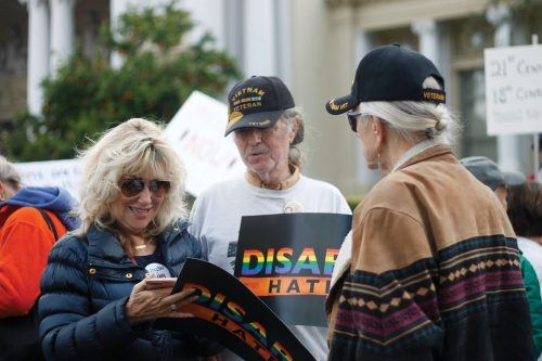 Sharon Davis, professor of sociology and criminology at the University of La Verne, Dan Kennan and Carl Ecklund attend Riverside's March for Our Lives at the Riverside Historical Courthouse on March 24, 2018. Carl, part Native American, is a Vietnam veteran and Dan's close friend. / photo by Celeste Drake