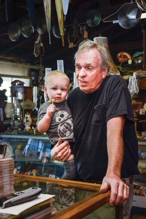 In addition to his two sons who work for him part time, Ken also has three grandchildren:  Gage, 6; Briley, 4; and Cash, 1 (pictured), who regularly visit the shop and  greet customers. / photo by Dorothy Gartsman
