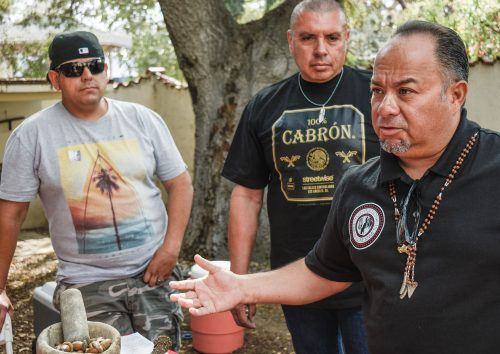 "Kizh Tribe chairperson Andrew ""Andy"" Teutimez Salas, with Covina resident Pete Perez and author James Henniger Aguirre, teach visitors at the Homestead Museum in the City of Industry about the history of their tribe and their many musical instruments. According to Aguirre, he has documents that prove his ancestors built the adobe structures and were slaves to the  Workman and Temple families, whose homes now constitute the museum. / photo by Natasha Brennan"