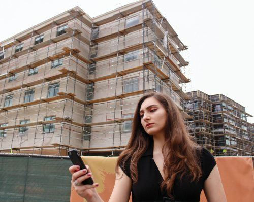 Nazeli Nalbantian, junior political science major, stands in front of the construction site of the new dormitory near Vista La Verne Residence Hall. Nalbantian says that community engagement days should take place where city residents clean up the streets or plant gardens to beautify the city. In addition, she suggests that city fairs and festivals should serve as fundraisers to build new facilities or to facilitate donations to non-profit organizations. / photo by Tyler Evains