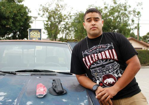 "Marco Cisneros, senior political science and philosophy major, has two holsters. The flip side of his red holster reads ""TRUMP, Make America Great Again."" He says that school shootings would be more manageable if teachers and students 21 and over were allowed to carry weapons on campus. Cisneros says that it is not the government's responsibility to control guns because it is the person who chooses to use a firearm immorally—guns themselves are not the issue. Cisneros is the former president of La Verne's chapter of Turning Point USA, a conservative organization that works to promote principles of Second Amendment rights, free markets, freedom and limited government. / photo by Tyler Evains"