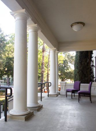 Present day velvet cushioned chairs on Miller Hall's front porch capture the elegance of its early 20th century look. / photo by Melody Blazauskas