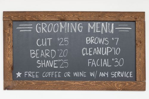 Different options are shown on the grooming menu at The Social Cut, including wine or coffee with any service. / photo by Ashley Villavicencio