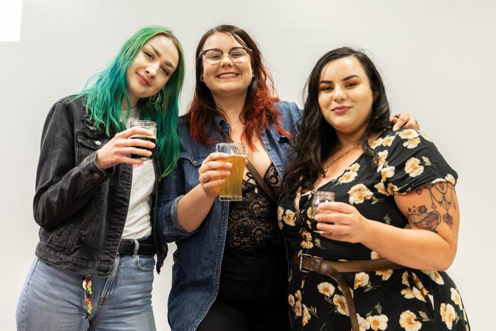 Toasting the philanthropic success of their organization, (l to r) Emma Wyatt, Sage Monroe and Destiny Romero are the organizing leadership of the Inland Empire Brew Witches. / photo by Jaren Cyrus