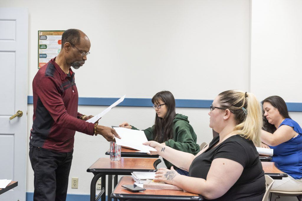 "In his ""Jesus and His Teachings"" class, Richard Rose, professor of religion and philosophy, asks his students to compare two religious texts for similarities. / photo by Katelyn Keeling"