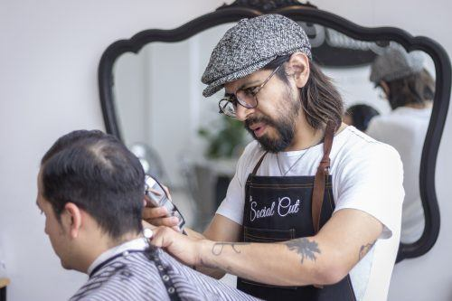 Steve A. Nuñez, Cal Poly Pomona alumnus and owner of The Social Cut, is an artist who found a home for his business in the heart of Pomona. / photo by Ashley Villavicencio