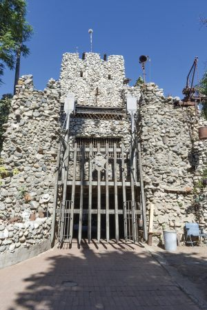 The Rubel Castle's massive front gates are the first view that greets visitors. The gates serve as a barrier to the outside community, hiding its secrets and eccentric design within. / photo by Kayla Salas