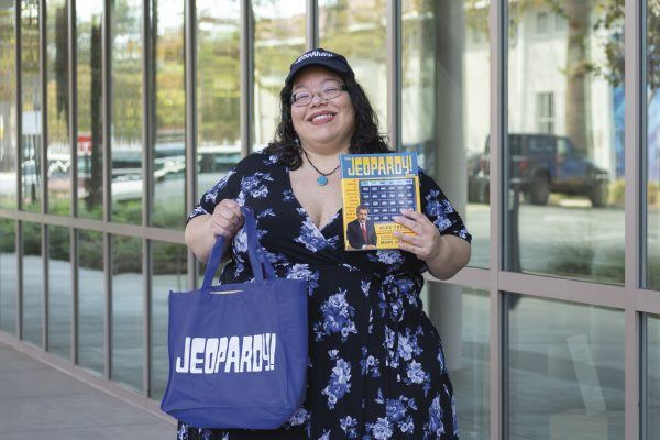 "Mary Ann Borer proudly sports her ""Jeopardy!"" merchandise after showing off her impressive knowledge on the show. / photo by Kayla Salas"