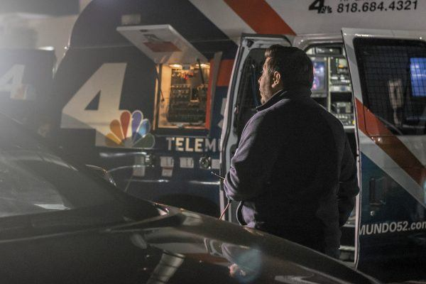 Bathed in bright television lights and standing by his KNBC truck with its mobile studio capability, Rick Montanez shows composure while delivering a live broadcast. / photo by Veronyca Norcia