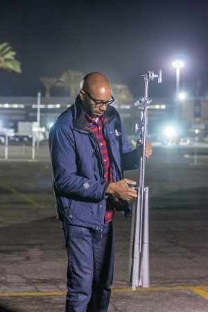 Photographer Troy McLaurin takes down the set within minutes of the live broadcast's end from Santa Anita Park. / photo by Veronyca Norcia