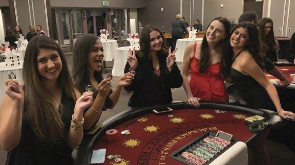 You do not have to leave campus for fun. Sigma Kappa members (l to r) Brianna Salcido, Jaycie Thierry, Remy Hogan, Sunny Blake, and Hannah Flores enjoy their annual Casino Night on campus in the Abraham Center. / photo by Shane Rodrigues