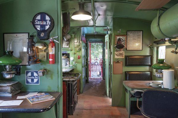 The Santa Fe Railroad caboose, reminiscent of the 1940s, used to be used as guest quarters for the Rubel Castle. / photo by Kayla Salas