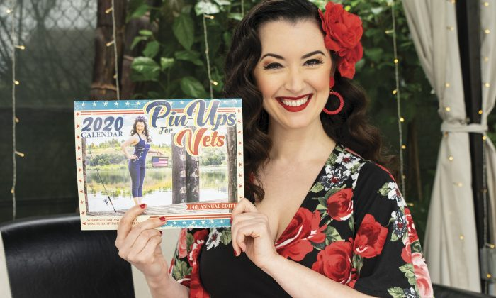 Gina Elise, founder of Pin-Ups for Vets, poses with her 2020 calendar at the Hotel Shangri-La, the site where the modern Navy Seal program was born. / photo by Maydeen Merino