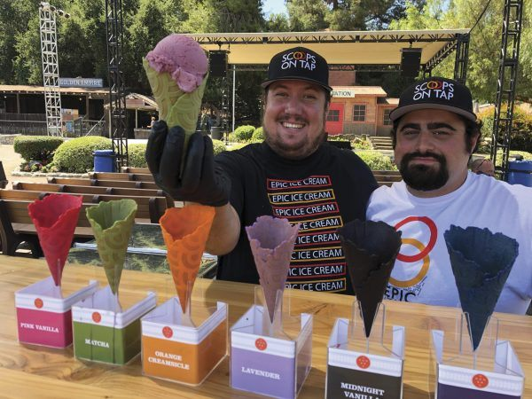 Scoops on Tap founders Sam Howland (left) and Bryan Marasco have a distinguished history of making customers and friends smile as they scoop up some of their delicious ice cream, including the blackberry buttermilk flavor (pictured) made of organic cream, buttermilk and milk, plus fresh Oregon marionberries. The ingredients are infused with blackberry sour ale from Ballast Point Brewing. / photo by George Keeler