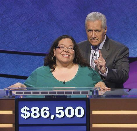 "Mary Ann Borer receives special on-air recognition from ""Jeopardy!"" host Alex Trebek, who often mimicked back her many show poses. / photo courtesy of Sony Pictures Entertainment"
