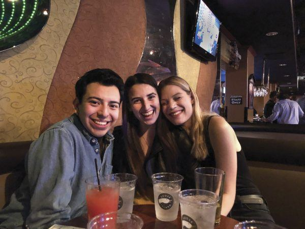 University of La Verne business major John Ceja, political science major Sunny Blake, and senior theater major Briana White celebrate the end of the fall semester at PianoPiano in Claremont. / photo by Remy Hogan
