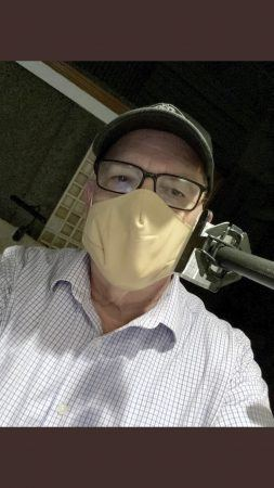 From the safety of his at-home work space, University of La Verne Professor of Communications Mike Laponis tests his new mask. / photo courtesy of Mike Laponis