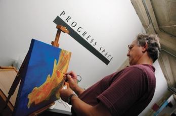 Artist Lucien van Oosten, from Glendora, paints a piece during the art walk. Van Oosten joined the Progress Space Gallery June 2005. / photo by Reina Santa Cruz