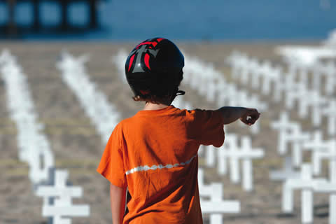 Henry Haprov, 9, like many children who see the crosses at the Santa Monica Pier, wonders if there are real bodies under the sand. / photo by Lindsey Gooding