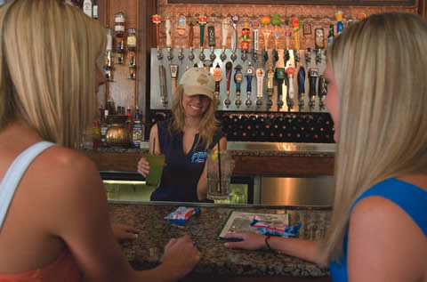When you walk in, head straight for the counter, where you will be greeted with a friendly face, like that of server Heather Shireman, who brings drinks to Laura Larsen and Kari Erickson. / photo by Emmah Obradovich