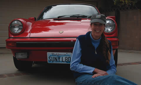 Staying true to her license plate, Maia Kinsinger cruises around in her 1980 Porsche only on sunny days. She saved her birthday money ever since she was 10-years-old to buy her prized possession. / photo by Lindsey Gooding