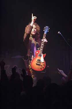 Pointing to the heavens above, Steve Zukowsky, Led Zepagain guitarist, prepares to make the rock gods proud with his dead-on portrayal of the legendary Jimmy page at the Galaxy Theater in Santa Ana, March 10, 2006. / photo by Jenna Campbell