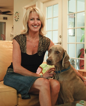 At her home in a quiet cul-de-sac on Second Street in La Verne, Donna Nasmyth shares a moment with her dog Shuman in her bright and inviting home. La Verne's newest city council member is the first woman to hold this position in the town's history. Nasmyth will continue to serve as an adjunct professor in the liberal studies department at the University of La Verne as well as an academic adviser for online students. / photo by Christina Carter