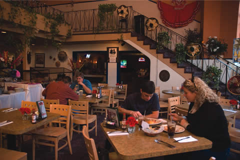 Casa de Salsa, with a popular Sunday brunch, features many favorite Mexican dishes. First–time customers Karen Nelunb, Brian Kibson, Louis Villa and Marty Martinez enjoy the fresh food. / photo by Emmah Obradovich