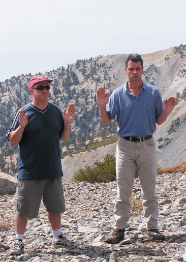 Gordon McKenzie, who has visited mountains sacred to Aetherians on three continents, recites the 12 Blessings with Paul Nugent on the east summit side of Mt. Baldy. / photo by Amy Babin