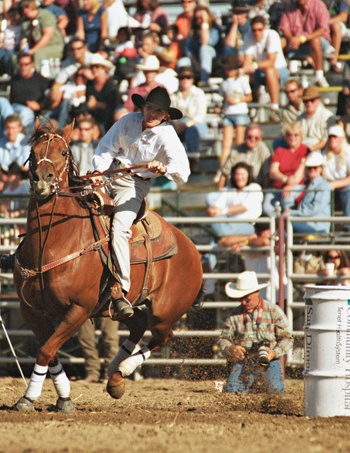 Sandy Arave, from Hemet, Calif., timed in at 17.05 seconds and placed third in the barrel racing competition at the eighth annual San Dimas Western Days Rodeo at Horsethief Canyon Park, Oct. 6, 2002. / photo by Liz Lucsko