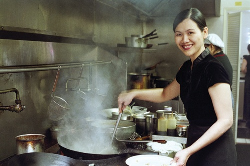 Mastering the art of Thai cuisine led Joyce Johnson to open a Thai restaurant in the United States. Her degrees in business administration and hospitality administration have helped her sustain the flourishing Bangkok Blue.  / photo by Yelena Ovcharenko