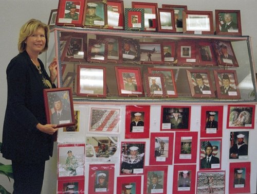In a display of patriotic love, Carla Sullivan, La Verne's community services superintendent, created a display case in La Verne City Hall recognizing the 62 La Verne residents currently serving overseas in the military. / photo by Emmah Obradovich