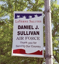 Flying high with pride, the personalized banner of Carla Sullivan's son Daniel is displayed outside La Verne City Hall. / photo by Emmah Obradovich