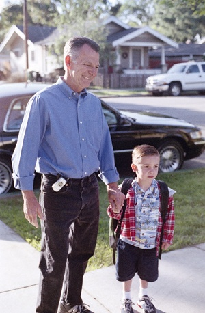 Leading the way three times a week, Mayor Jon Blickenstaff walks grandson Bryce to school. / photo by Gloria Diaz