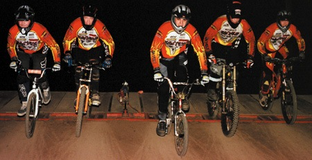 Exploding out of the gates, BMX In Cycle team members Chris Lucas, 23, from La Verne; Rick Lund, 22, from Covina; Bud Evans, 19, from San Dimas; Bryon Bushatz, 22, from Glendora; and Brian Arch, 24, from Pomona ride at least once a week on the Coal Canyon BMX track, pushing for faster times and polishing their tricks. / photo by Matt Wright