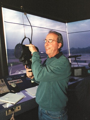 In the situation where a plane is unable to communicate with the tower through radio, light guns are used to communicate tower instructions to the pilot. Greg Leathley, who has worked in flight control since 1965, mans the light gun. / photo by Matt Wright