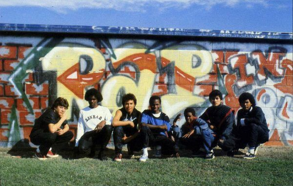 The G Rockers pose in front of a mural they painted at their school. / photo by Tom Comeau