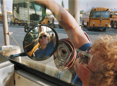 There are 22 buses and vans used during a regular workday in the Bonita Unified School District. About once a week, usually around 4:10 p.m., district bus driver Beverly Gaunt can be found polishing her own image as she cleans her bus. Gaunt has been driving buses for BUSD since 1989; she wants her passengers to ride in comfort and security as they travel to and from school. Of the 13 schools to which these buses travel, Gaunt's bus is one of only two properly equipped for wheelchair access. / photo by Veero Der-Karabetian