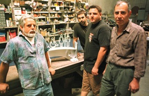 From signs in movies to signs on buildings and, yes, even signs in restrooms, Creative Metal Arts does it all. Currently, (left to right) Ken Hiebsch Sr., John Bishop, Ken Hiebsch Jr., and Rafik Haroutounian are busy making metal sign art for the Long Beach Aquarium. / photo by Michael P. Bailey