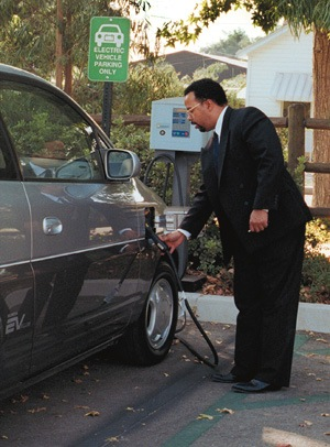 Fueling his vehicle free of charge, Keith Young, senior code compliance officer for the city of San Dimas, gained his Honda EV1 for work use from the State of California Air Resources Board as part of a program to encourage environmentally sound transportation. / photo by Michelle Zimmerman