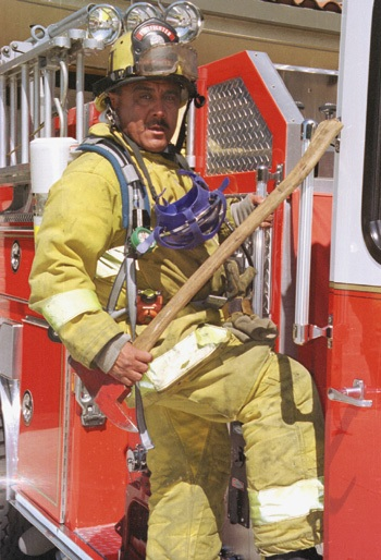 Proud of the community that he serves, La Verne firefighter David A. Castañon is fulfilling his lifetime goal. Castañon, a family man, chose to raise his family in La Verne after experiencing the benefits of growing up in this community. / photo by Rhidian Maehl