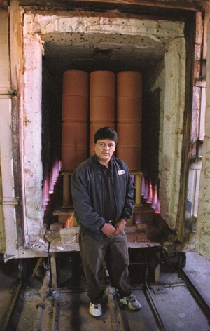 Facundo Leon, Gainey Ceramics plant manager, stands before a 2,000 F kiln loaded with glazed terra cotta. The ceramics will be burned for about eight hours during the final steps of production. / photo by Ryan Sones