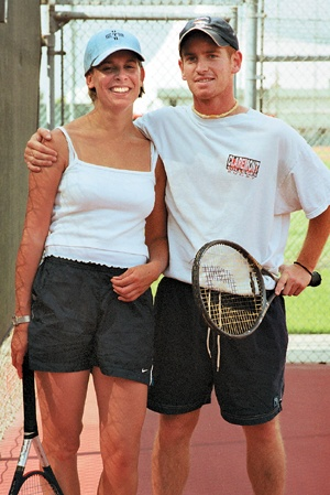 """Affected little by the events of Sept. 11, international students Matt Reilly, England, and Melanie Hanik, Germany, continue to enjoy their tennis games. Reilly says, """"It was interesting to see how another culture deals with terrorism,"""" referring to his country's struggle with the Irish Republican Army. / photo by Juan Garcia"""