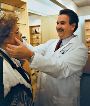 Looking for the perfect fit, Ethel Edwards leaves her eye sight in Dr. David Krasnow's hands. In the mid-1980s, Dr. Krasnow founded VOSH (Volunteer Optometric Services to Humanity). When he is not volunteering his services, he maintains a private practice in Beverly Hills, Calif. / photo by Jen Newman