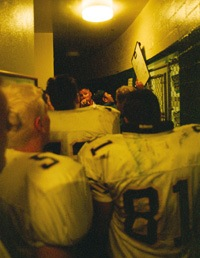 "The locker room was tense at halftime. San Dimas Head Coach Ted Clarke told his players what they needed to do to build on their lead: ""Hit somebody!"" / photo by Jason Cooper"
