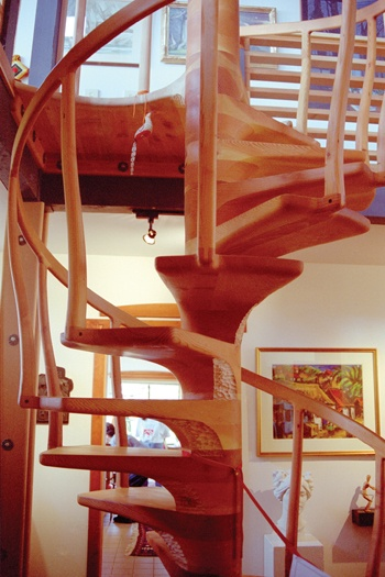 Stairway to an art lover's heaven—Woodworker Sam Maloof built a spiral staircase in his new house after workers built a straight staircase. The staircase leads to an art gallery that includes work by his granddaughter Rebecca. / photo by Sylvia Castallanos