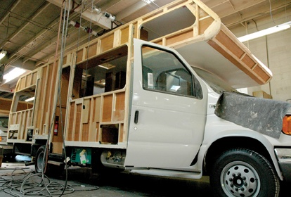 In the Lazy Daze workshop, motor homes are built from the ground up on a Ford E-450 super duty chassis. Owners Ed and Steve Newton employ 70 workers and have a five- to seven-month waiting list. / photo by Reina Santa Cruz