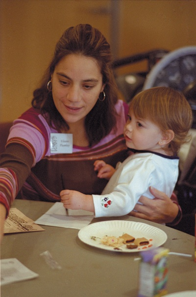 Eilean Plumley has her hands full with daughter Madison at a Moms Club meeting. / photo by Sylvia Castellanos